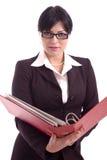 Junge Geschäftsfrau, die eine Dateihalterung anhält Stockfotografie