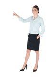 Junge Geschäftsfrau, die, getrennt zeigt Stockbild