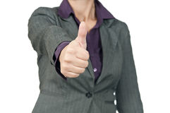 Junge Geschäftsfrau, die Hand anhebt und Zeichen-O.K. zeigt. Stockfoto