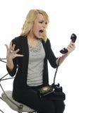Junge Geschäftsfrau, die telefonisch schreit Stockbilder