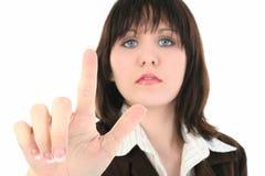Junge Geschäftsfrau mit dem Holding-Finger oben lizenzfreie stockfotos