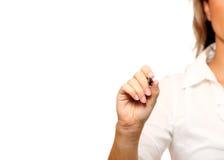 Junge Geschäftsfrau mit einer Markierung Lizenzfreie Stockfotos