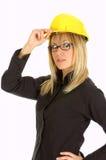 Junge Geschäftsfrau mit Helm Lizenzfreie Stockbilder
