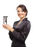 Junge Geschäftsfrau mit Hourglass Stockfoto