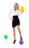Junge Geschäftsfrau mit Kugeln Lizenzfreie Stockfotografie