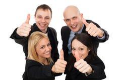Junge Geschäftsleute, die sich Daumen zeigen Lizenzfreie Stockfotos