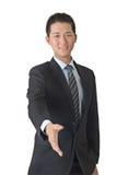 Junge Geschäftsmann-Erschütterunghand Lizenzfreie Stockbilder