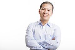 Junge Geschäftsmannstellung lokalisiert auf Weiß Stockfotos