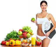 Junge gesunde Frau mit Früchten. stockfotografie
