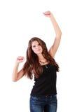 Junge glückliche Brunettefrauentänze Lizenzfreie Stockfotografie