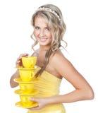 Junge glückliche Frau mit Cup über Weiß Stockfotos