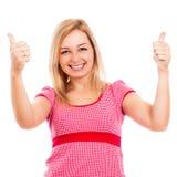 Junge glückliche Frauendaumen oben Lizenzfreie Stockfotografie