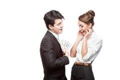 Junge glückliche Geschäftsleute, die Geld anhalten Stockbilder