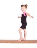 Junge Gymnastschwerpunkte auf Lichtstrahl Lizenzfreies Stockbild