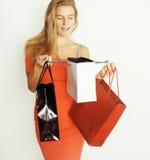 Junge hübsche Frau mit Taschen auf Weihnachtsverkauf herein Stockbilder