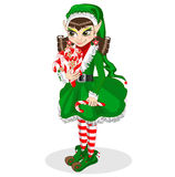 Junge herrliche Frau als Weihnachtself auf goldenem Hintergrund mit leerer Rolle Stockbilder