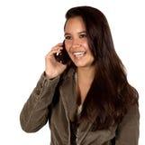 Junge hispanische Frau am Telefon lizenzfreie stockfotos