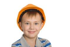 Junge im Aufbausturzhelm. Lizenzfreies Stockfoto