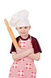 Junge im Hut des Chefs Stockfoto