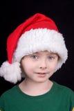 Junge im Weihnachtshut Stockfoto