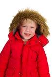 Junge im Wintermantel Stockbild