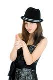 Junge Jugendliche des attraktiven Brunette mit der Hand in der Form eines Gewehrs stockfotos