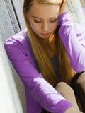 Junge jugendliche traurige Frau Lizenzfreie Stockbilder