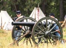 Junge Kanonen-Mannschaft Lizenzfreie Stockfotos