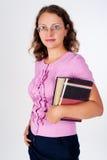 Junge kaukasische Frau mit Büchern Stockfoto