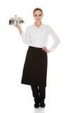 Junge Kellnerin, die Behälter und Deckel hält Lizenzfreie Stockfotografie