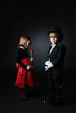 Junge Kinder in der formalen Kleidung Stockfotos
