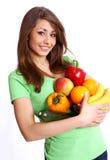 Junge lächelnde Frau mit Früchten Lizenzfreies Stockfoto