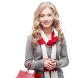 Junge lächelnde Frauenholding-Einkaufenbeutel Stockbild
