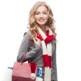Junge lächelnde Frauenholding-Einkaufenbeutel Stockbilder