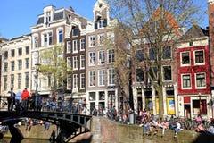 rotes fahrrad neben einem kanal in den niederlanden. Black Bedroom Furniture Sets. Home Design Ideas