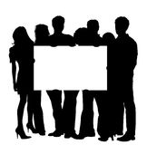 Junge Leute mit unbelegtem Schild Stockbild