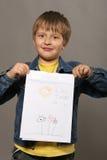 Junge mit Abbildung Stockfoto