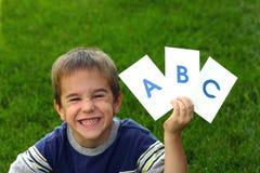 Junge mit ABC Stockbild