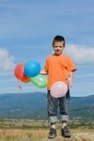 Junge mit Ballonen Stockbilder