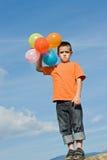 Junge mit Ballonen Stockbild