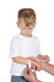 Junge mit bandaid Stockfotografie