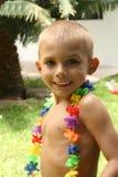 Junge mit Blumen Stockfotografie