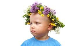 Junge mit Blumen Lizenzfreie Stockfotografie