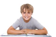 Junge mit Buch Stockbild