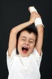 Junge mit der gebrochenen Hand in der Form Stockbild