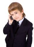 Junge mit einem Mobiltelefon Stockfotografie