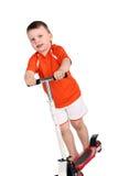 Junge mit einem Roller stockbilder
