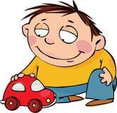 Junge mit einem Spielzeug Lizenzfreies Stockfoto