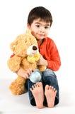 Junge mit einem teddybear Lizenzfreies Stockbild