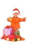 Junge mit Flitter und Geschenken Stockfotos
